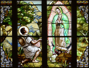 Stained glass window of Our Lady of Guadalupe appearing to St. Juan Diego at St. Peter's Catholic Church in Volo, IL created by Daprato Rigali Studios
